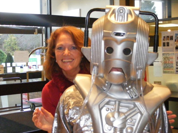 Louise Jameson photobombs a Cyberman at Dimensions 2012.