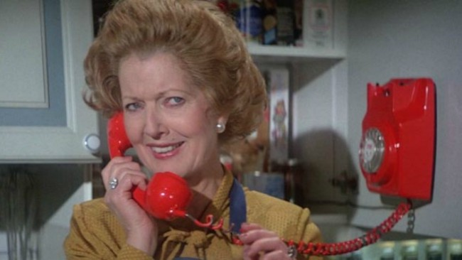 "Bond receives a phone call from the British Prime Minister, Margaret Thatcher. She does not know that she has a conversation with Melina's parrot. ""Give us a kiss""."